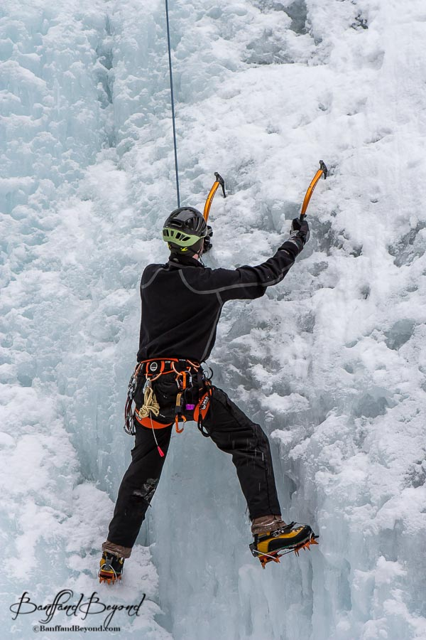 close up of ice climber with ropes and harnesses