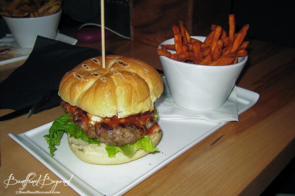 burger and yam fries at the outpost pub at the post hotel in lake louise