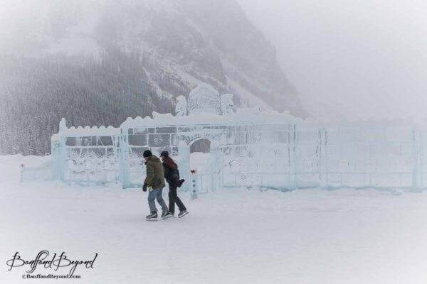 couple-romance-ice-skating-lake-louise-outdoor-rink-winter