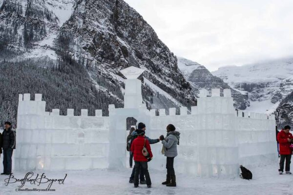 carved-ice-castle-lake-louise-skating-rink-outdoor-mountains-winter-tourist-activity