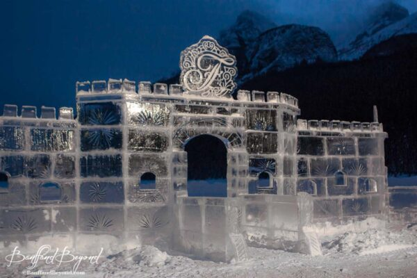 frozen-ice-castle-lake-louise-illuminated-night-winter-skating-rink-snow