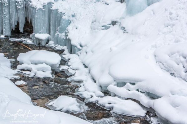 snow-cascading-creek-johnston-canyon-winter-hiking-banff-national-park