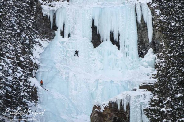 climbers on frozen louise falls