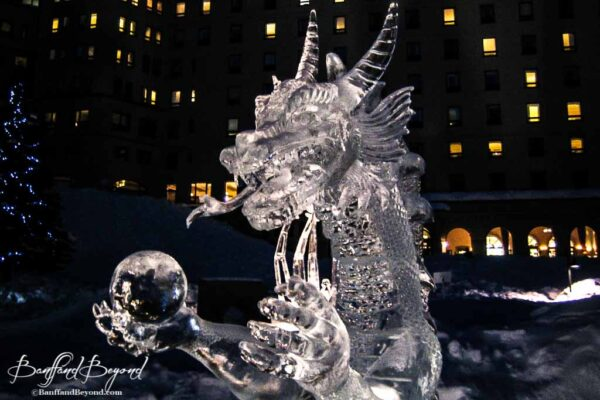 dragon sculpute lit at night lake louise ice magic