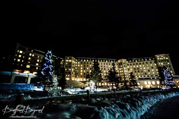 fairmont chateau lake louise hotel lit up at night