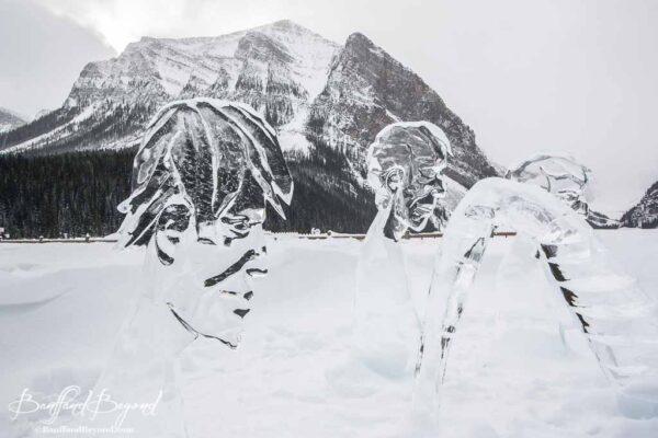 human faces ice sculpture lake louise
