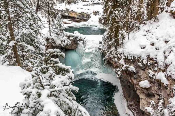 set of frozen winter waterfalls in johnston canyon
