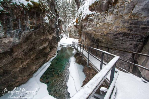 suspended-catwalk-winter-trail-johnston-canyon-snow-ice-walk-frozen-waterfalls