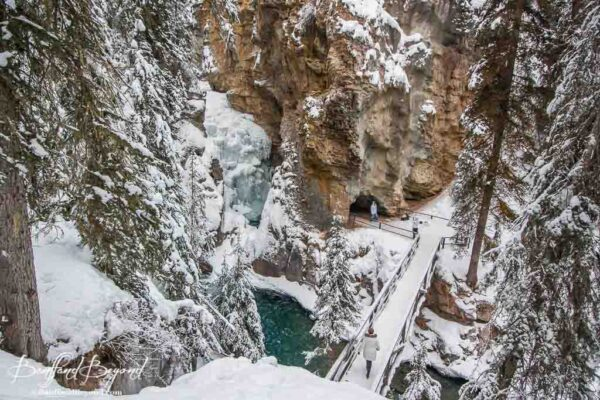 view looking down to lower falls in johnston canyon in winter