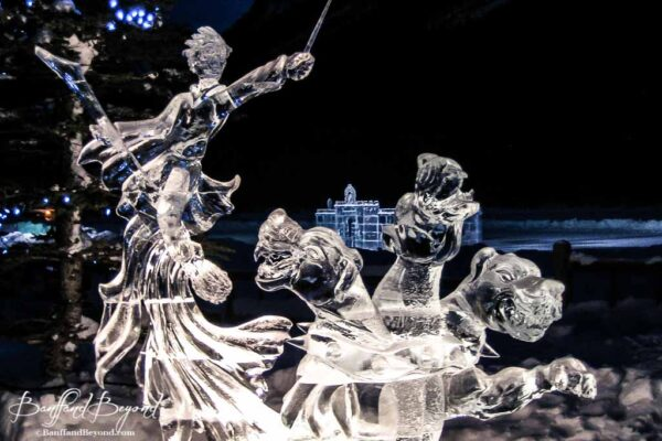 warrior sculpture and three headed dragon lake lousie ice festival