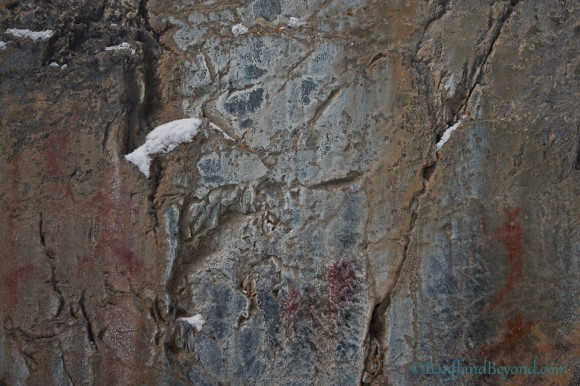 human-animal-ancient-pictograph-red-ochre-drawing-limestone-cliff-face-grotto-canyon-canmore-alberta