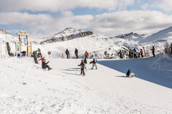 skiers at top of lake louise ski resort