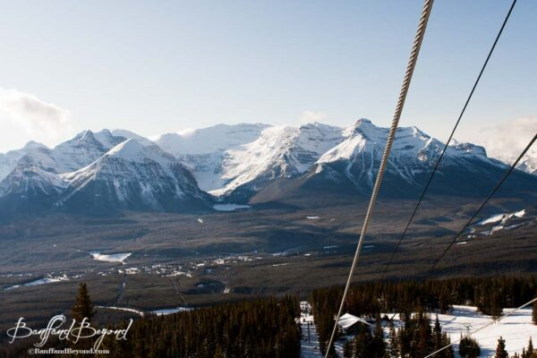 views of mountain ranges and lake louise from ski resort