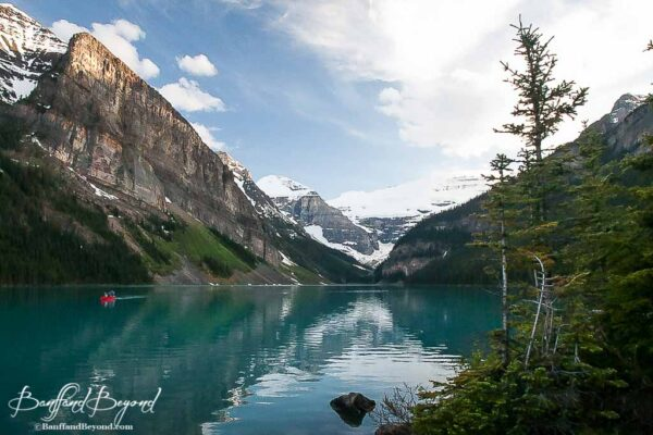 canoe on tranquil lake louise