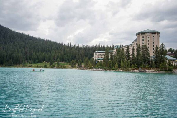 canoe paddling on lake louise near chateau hotel