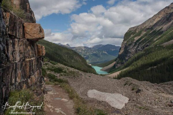 chain ropes along steep area of plain of six glaciers hiking trail