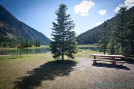 picnic-table-small-park-field-british-columbia-yoho-national-park-trees-mountains