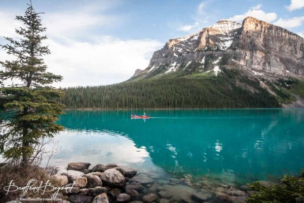 one canoe in solitude on tuquiose waters of lake louise