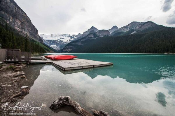 red canoes and docks at lake louise boathouse