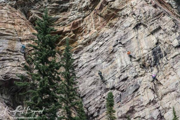 rock climbers on the cliffs at the back of lake louise