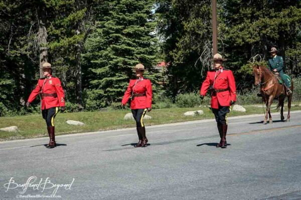 royal canadian mounted police marching in lake louise canada day paradge
