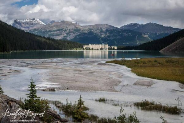 view of glacial silt running into the back of lake louise