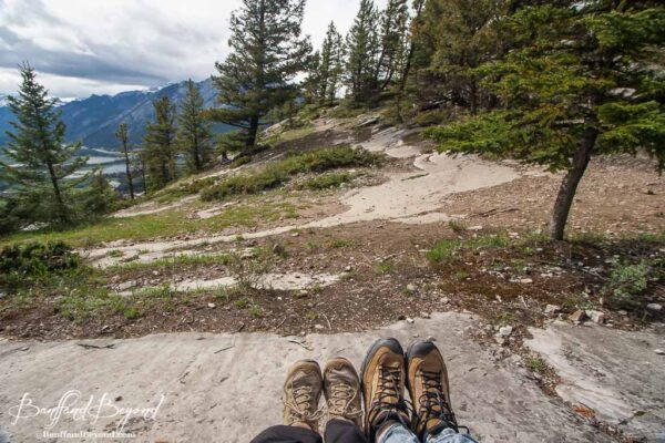 view of hikers shoes as they relax at the top of tunnel mountain summit in banff