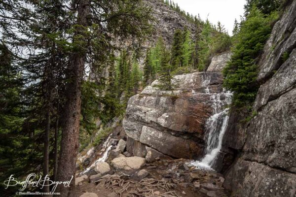 waterfall along the lake agnes tea house trail in lake louise