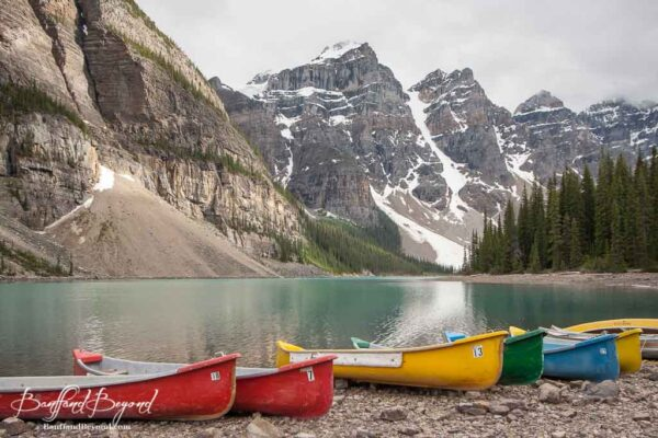 colorful canoes for rent at moraine lake