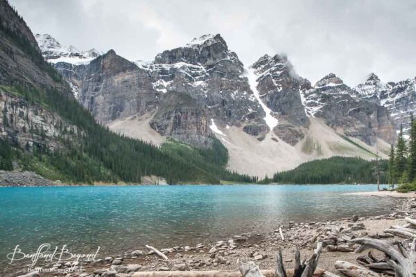 deep blue water of moraine lake and valley of the ten peaks