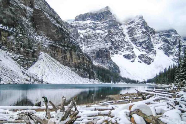 deep blue water of moraine lake with snow on the ground