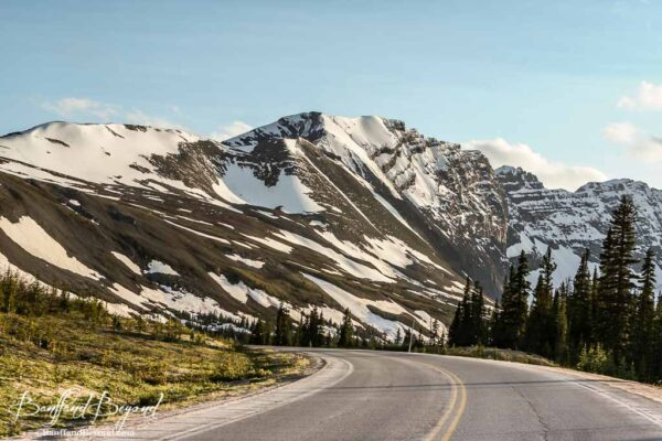 patches of snow on mountains along the icefields parkway near parker ridge