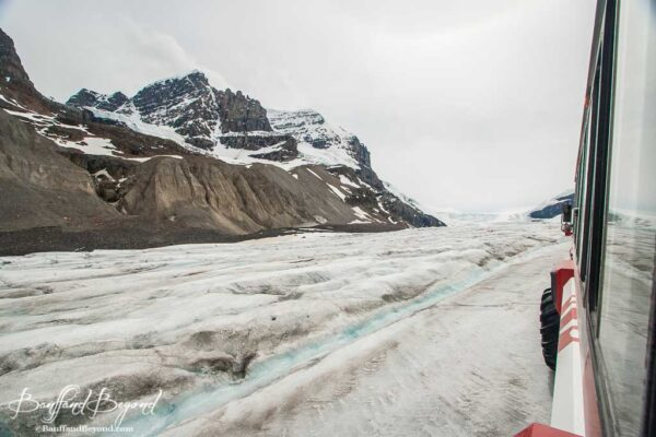 ice explorer traveling along athabasca glacier at the columbia icefields