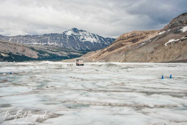 ice explorer traveling across the athabasca glacier at columbia icefields