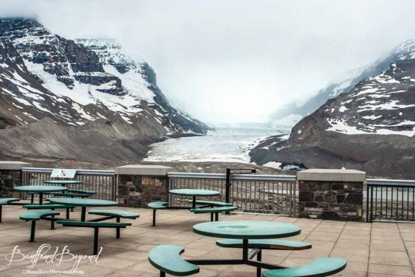 seating tables at the icefields center looking at the glacier