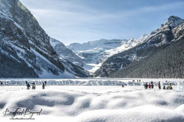 skating-frozen-lake-louise-winter-activity-banff-national-park-tourist-attraction