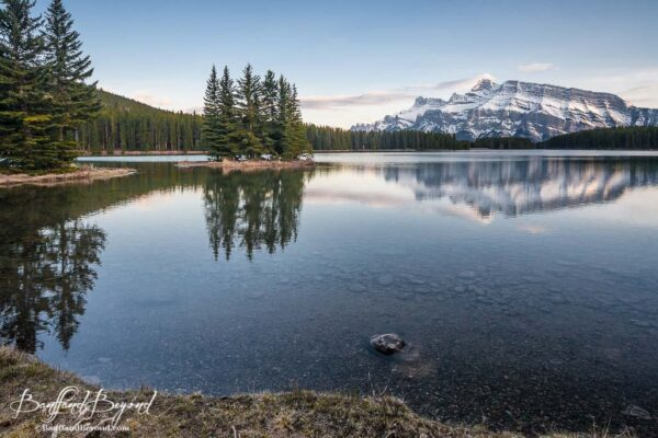 mountain reflections in water at two jack lake in banff