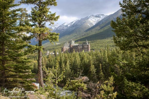 surprise corner view of banff springs hotel and mountains