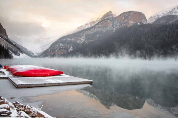 early-misty-morning-lake-louise-fog-bright-red-canoe-rentals-boat-house-tourist-attraction-banff-national-park-alberta-canada