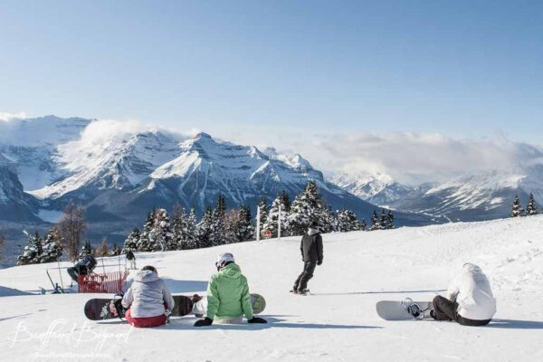 snowboarders on the top of lake louise ski hill