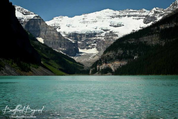 blue green turquoise water of lake louise early july