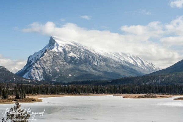 mount rundle and vermilion lakes slightly frozen in spring