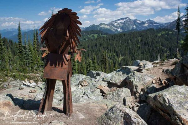 first nations sculpture on the first footsteps trail on mount revelstoke